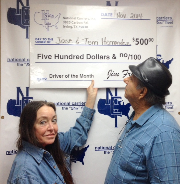 Terri and Jose Hernandez display their bonus check.