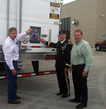 Johnny Branstine Director of Maintenance, Brigadier General Thomas W. Kula, and  Jim Franck, President of National Carriers, Inc.