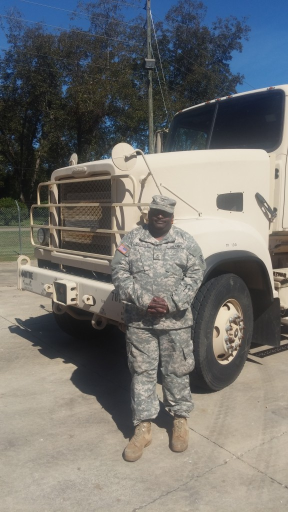 Darrel poses with his military issued Freightliner 915-A5 truck