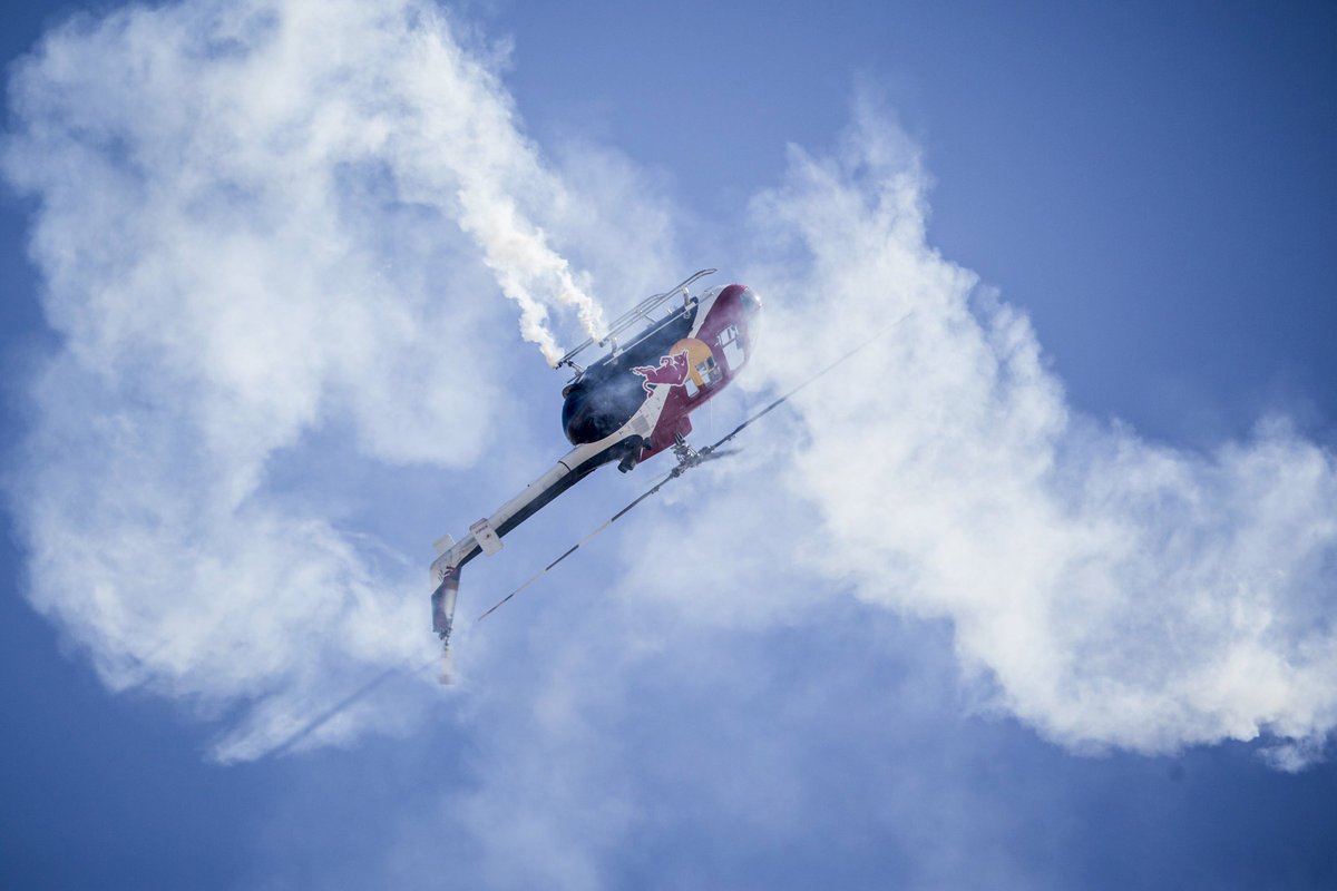 Helicopter pilot Chuck Aaron of the United States performs during the finals for the seventh stage of the Red Bull Air Race World Championship at the Las Vegas Motor Speedway in Las Vegas, Nevada, United States on October 12, 2014. // Andreas Langreiter / Red Bull Content Pool // VIN: SI201410130150 // Usage for editorial use only // Please go to www.redbullcontentpool.com for further informations. //