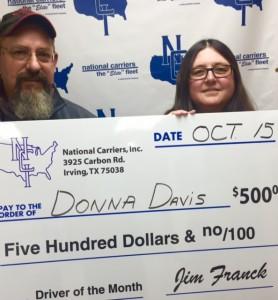 Driver Manager Phil Eade presents check to Donna Davis